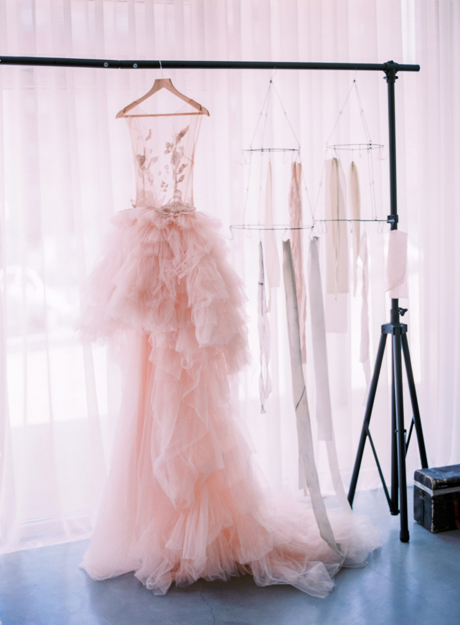 Blush Musat gown with floral appliqués and a dramatic tulle skirt
