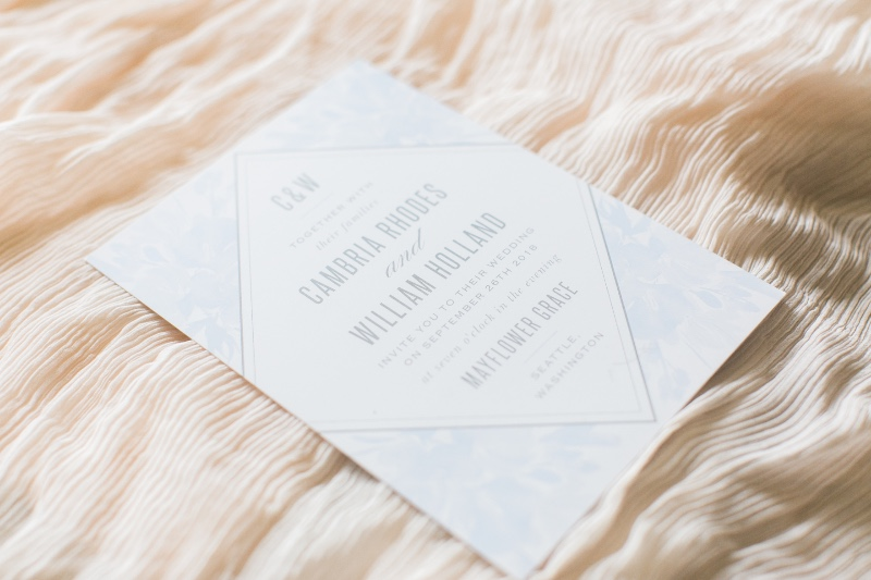 A new look at Basic Invite - the Subtle Fleuriste Wedding Invitation. A modern take on a traditional floral design.