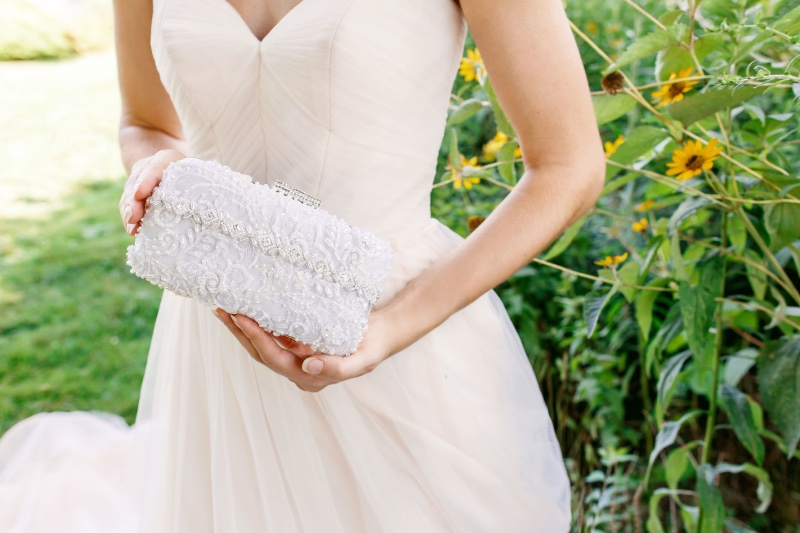 Simple yet elegant beauty in this Couture bridal clutch.