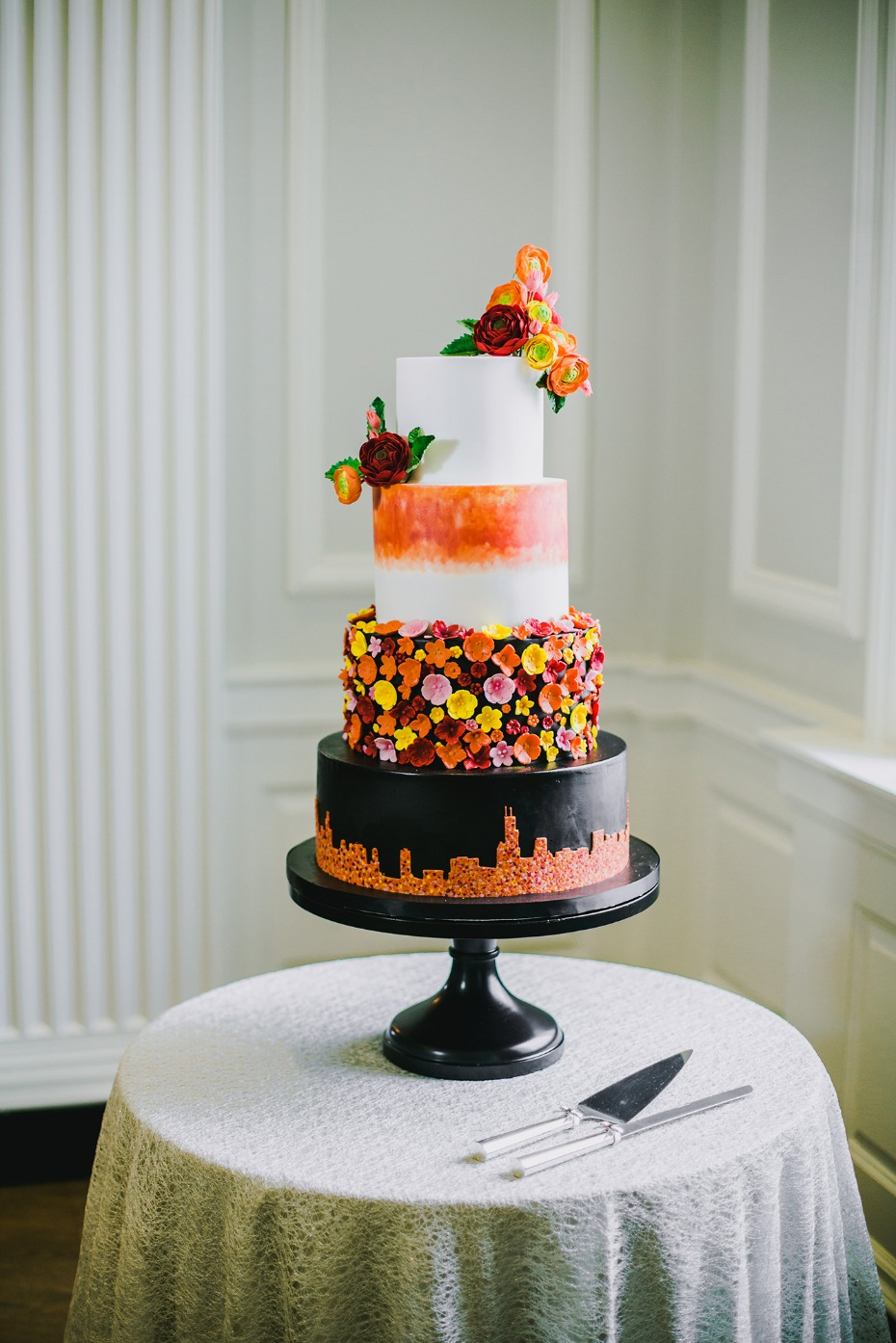 Bold & modern orange and black wedding cake