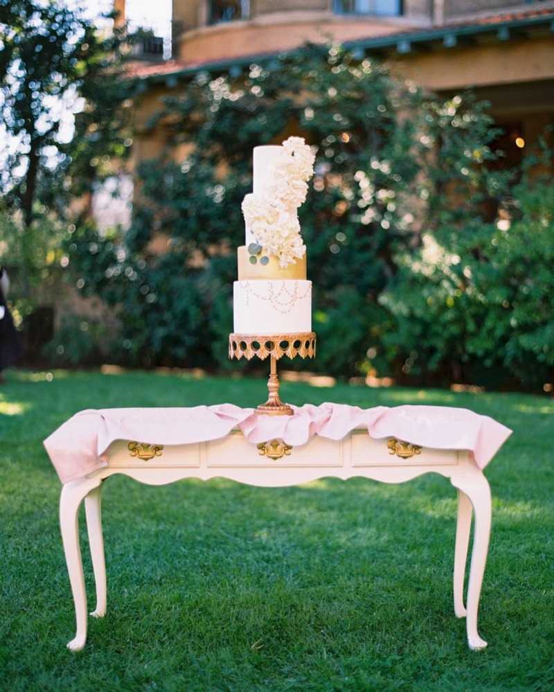 Wedding Cake Table Ideas! White Vintage desk with Gold Metal Crown Wedding Cake Stand created by Opulent Treasures.