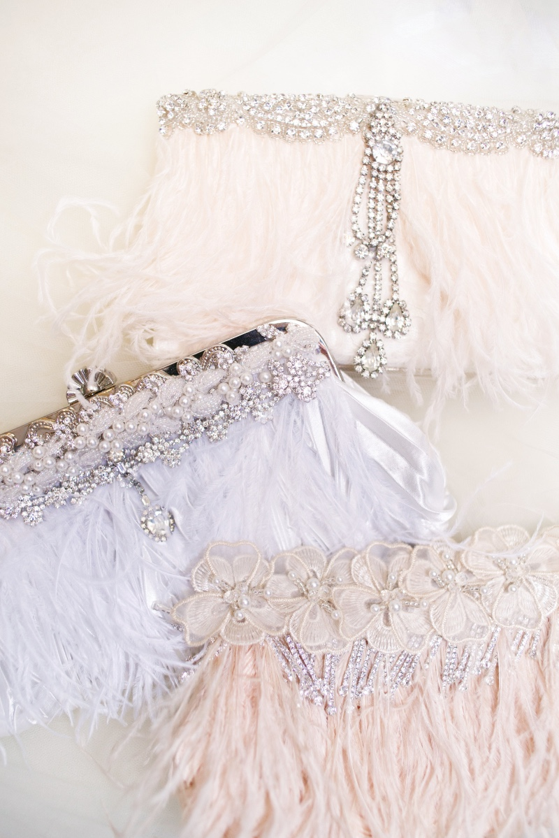 Dreamy couture bridal clutches designed with Ivory or blush feathers.