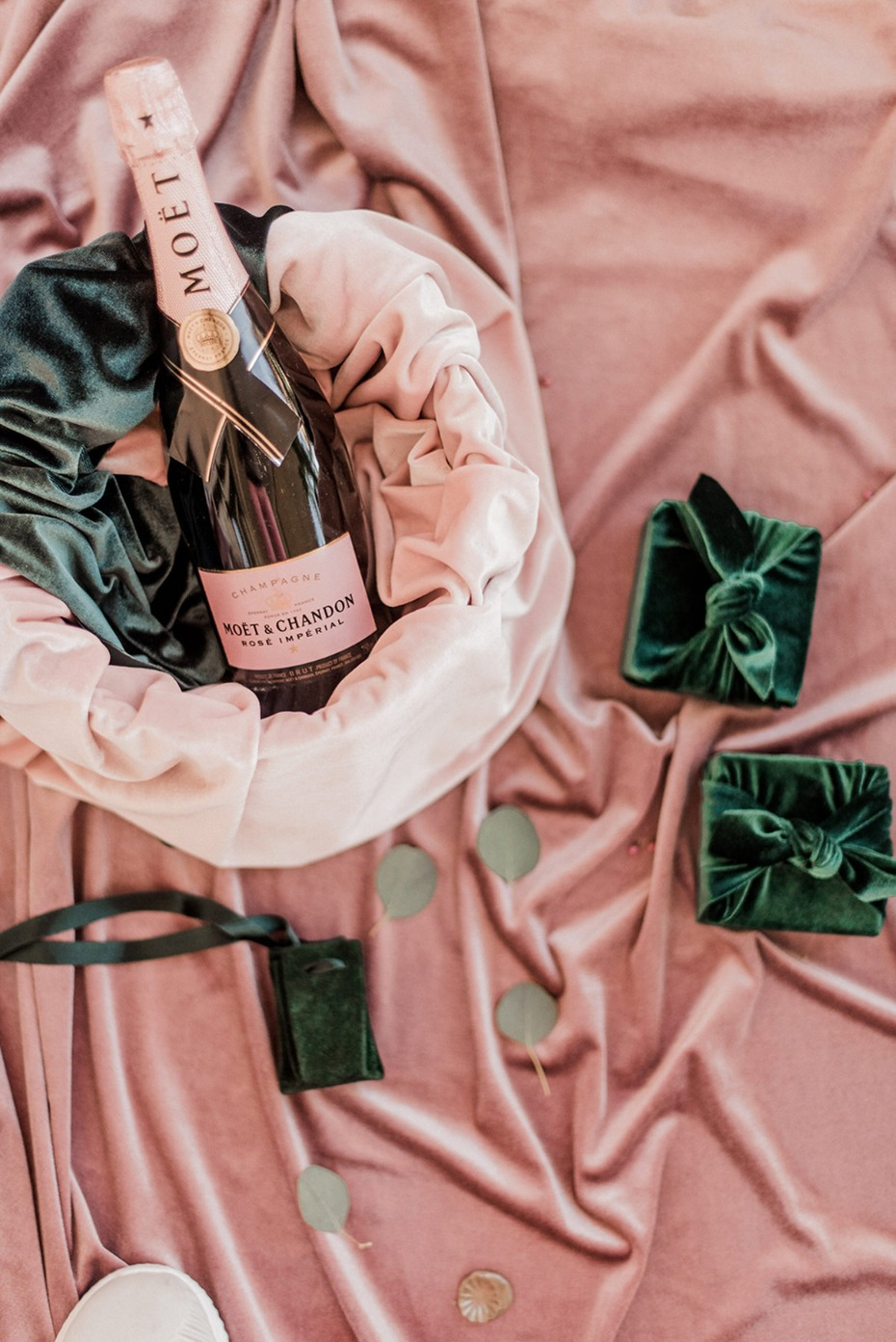 velvet wrapped favors and champagne