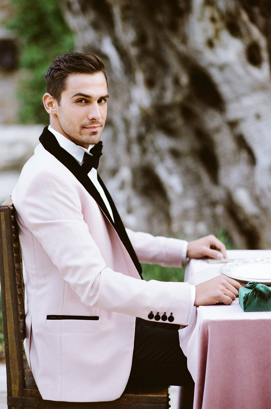 groom in soft pink and velvet jacket