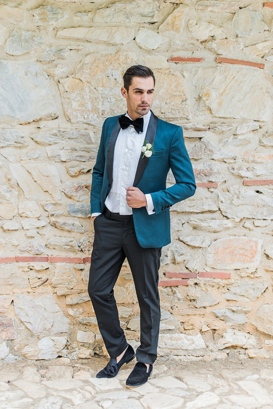 groom in emerald green and black for his late fall wedding
