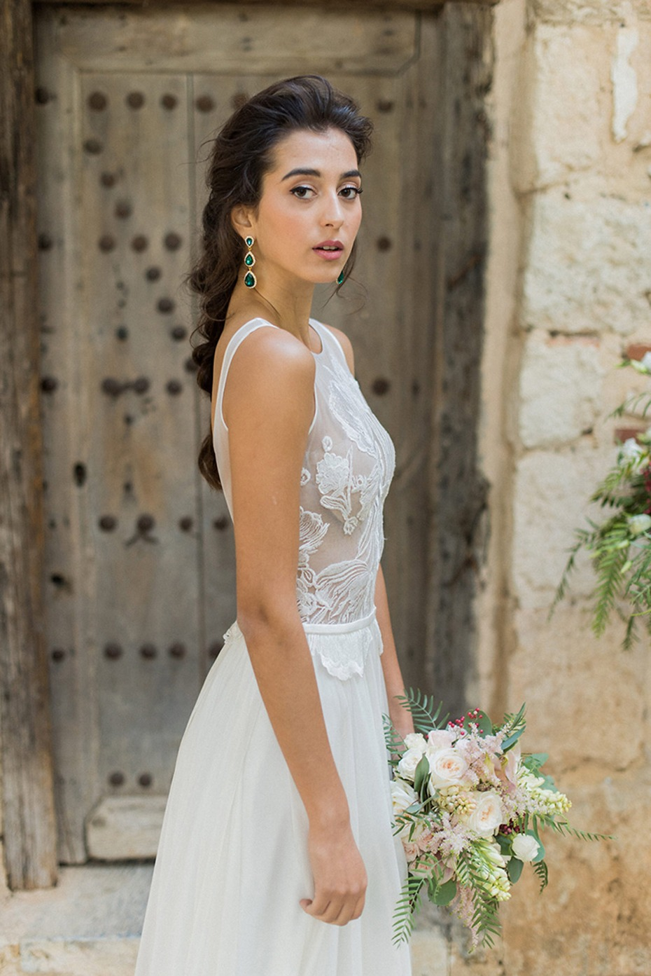 sheer top wedding gown and emerald tear drop earrings