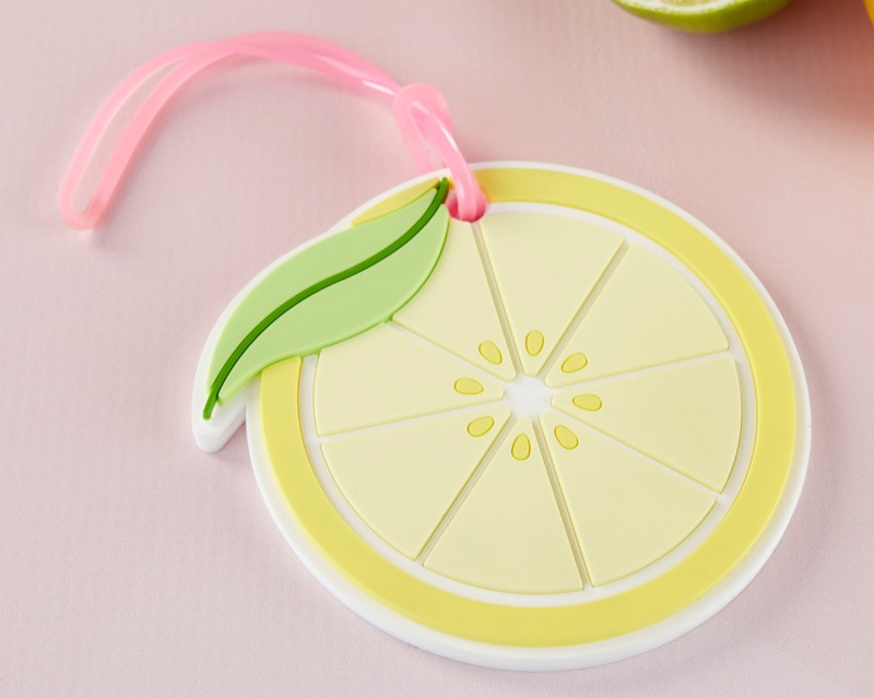 Planning a tropical destination wedding? Guests will love our Lemon Slice Luggage Tag favors! With a lemon theme, this is a luggage