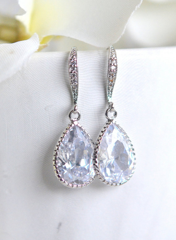 The drops are cubic zirconia set in silver plated brass and measure 12.5x 20mm. The ear wires have cubic zirconia on them as well.