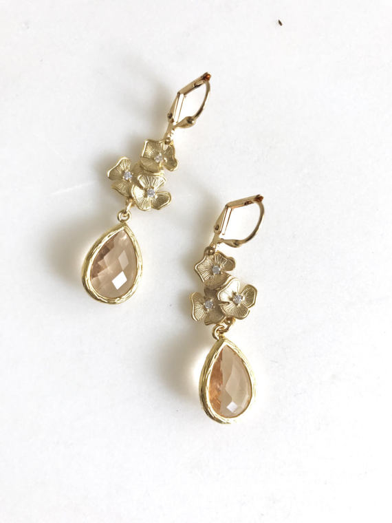 Champagne and gold are paired beautifully in these elegant earrings. Alive and gorgeous, these earrings will add a beautiful element