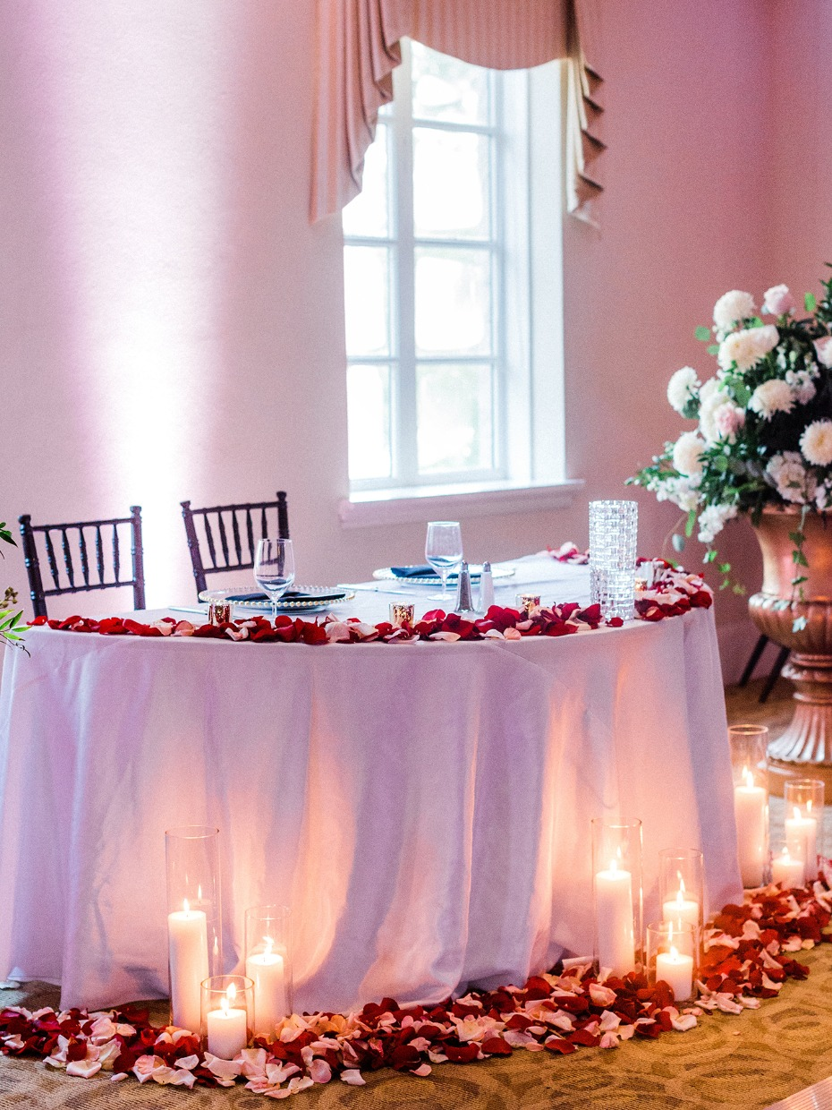 Cover your sweetheart table in rose petals