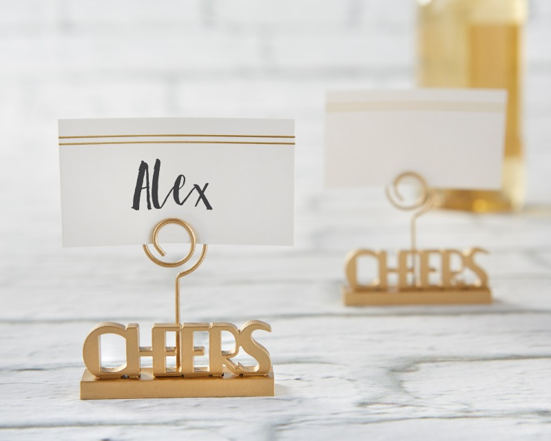 For your wedding, choose beautiful table décor that is also functional! These cheers to You Gold Place Card Holders help display seat