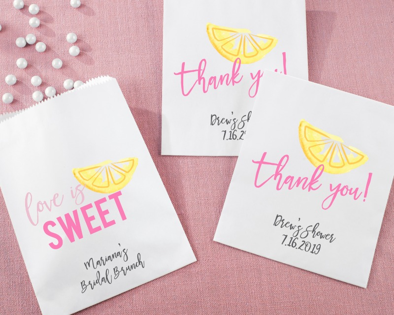 These Personalized Citrus themed Goodie Bags, adorned with a bright citrus slice and your choice of Love Is Sweet or Thank You,