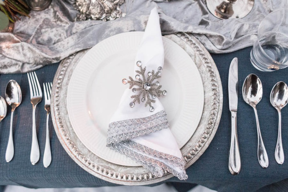 snowflake napkin holder and silver charger for your winter wedding table