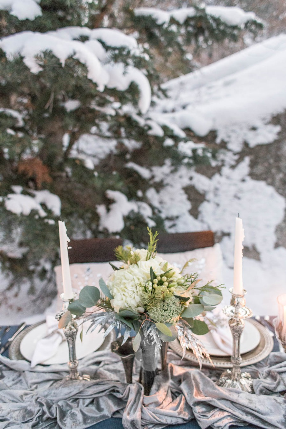 winter wedding table centerpiece with silver runner