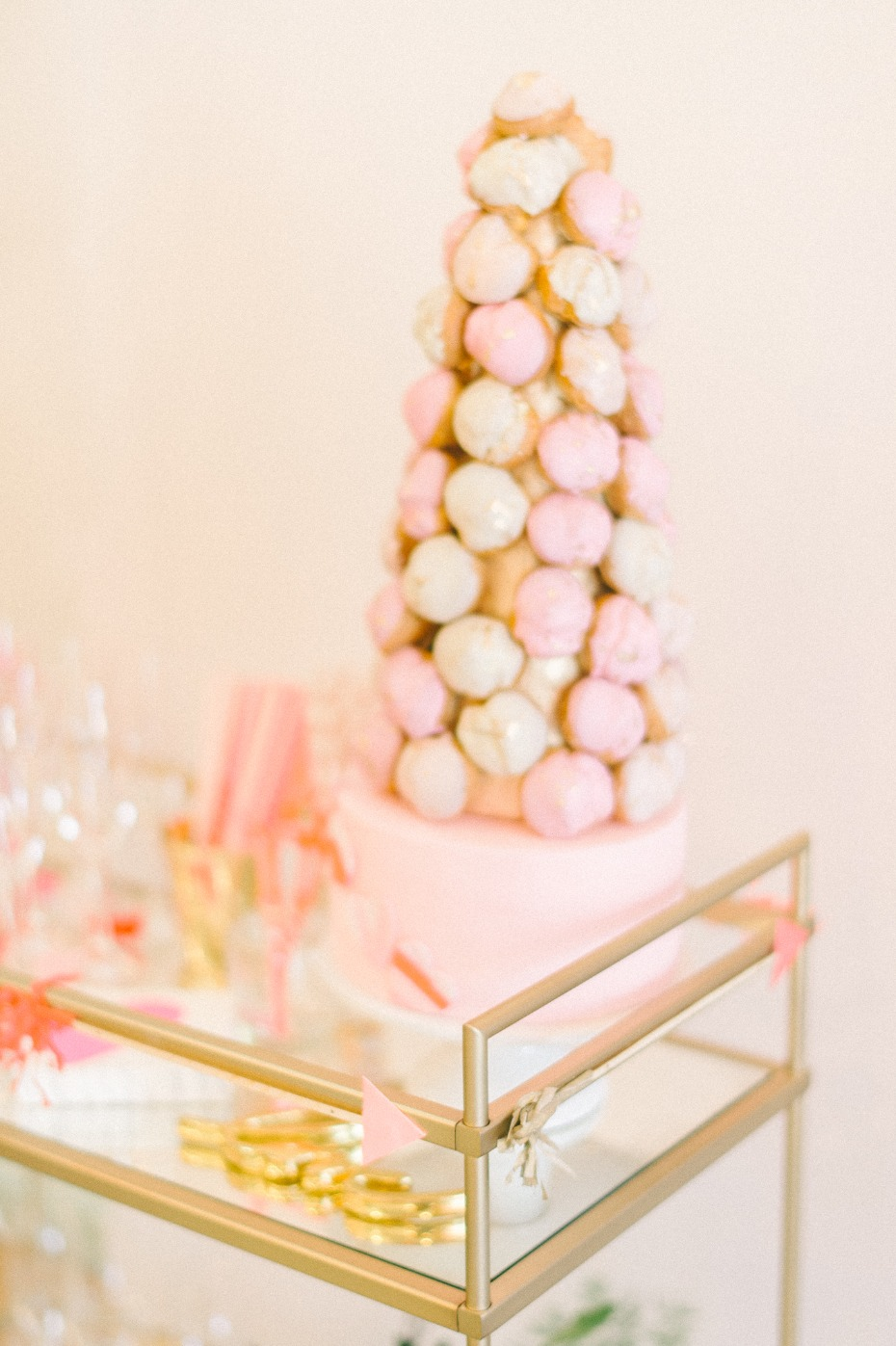 white and pink croquembouche cake