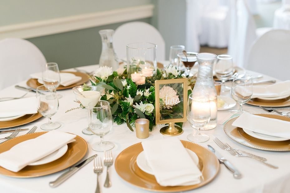 gold and white wedding table decor with clear table number