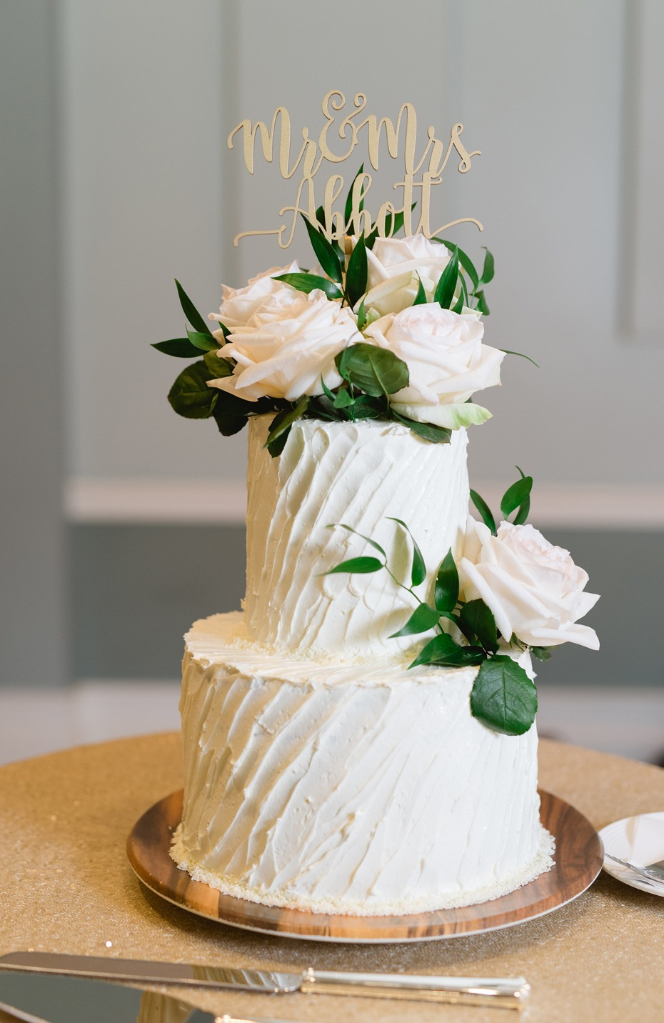 romantic classic white wedding cake topped with white roses