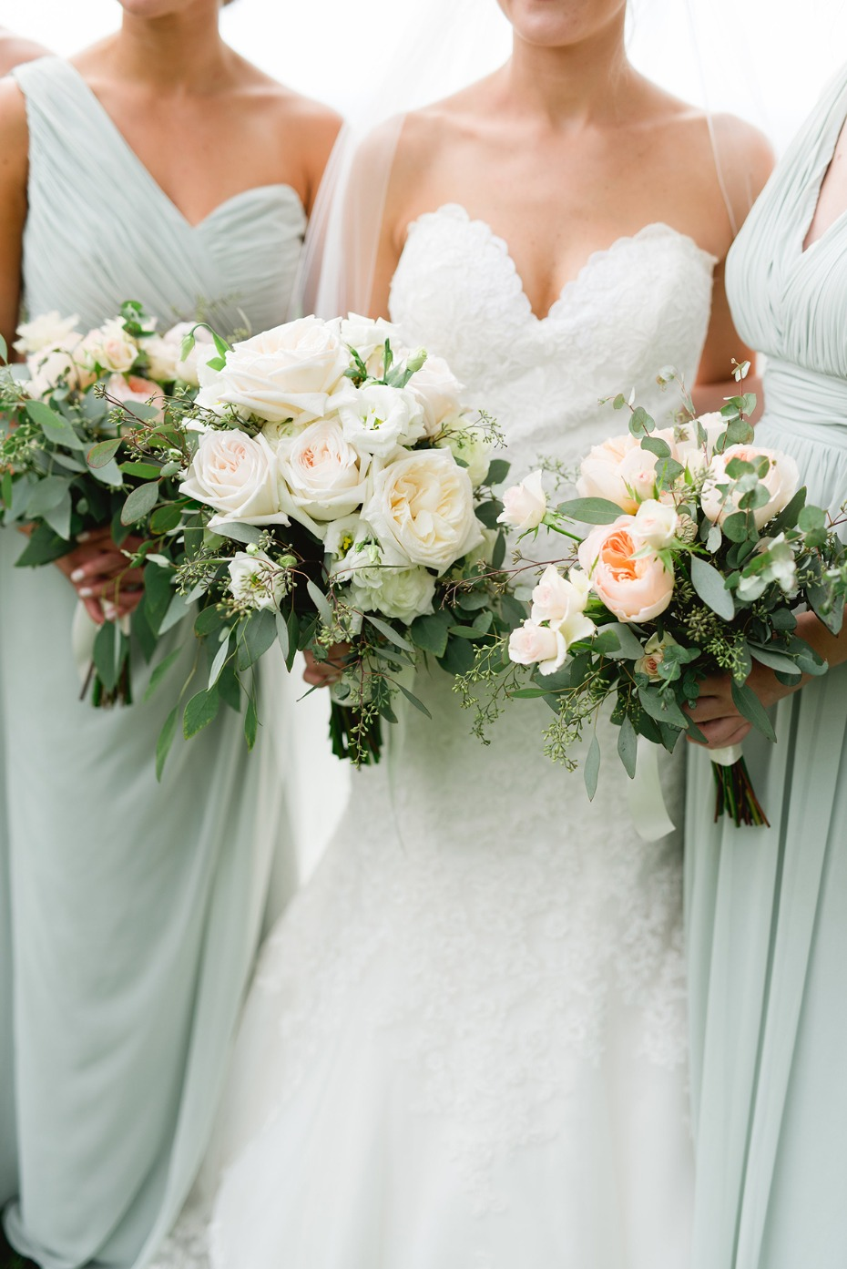 soft mint bridesmaid dresses with peach and white bouquets