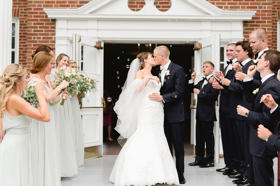 newlyweds with a bubble exit