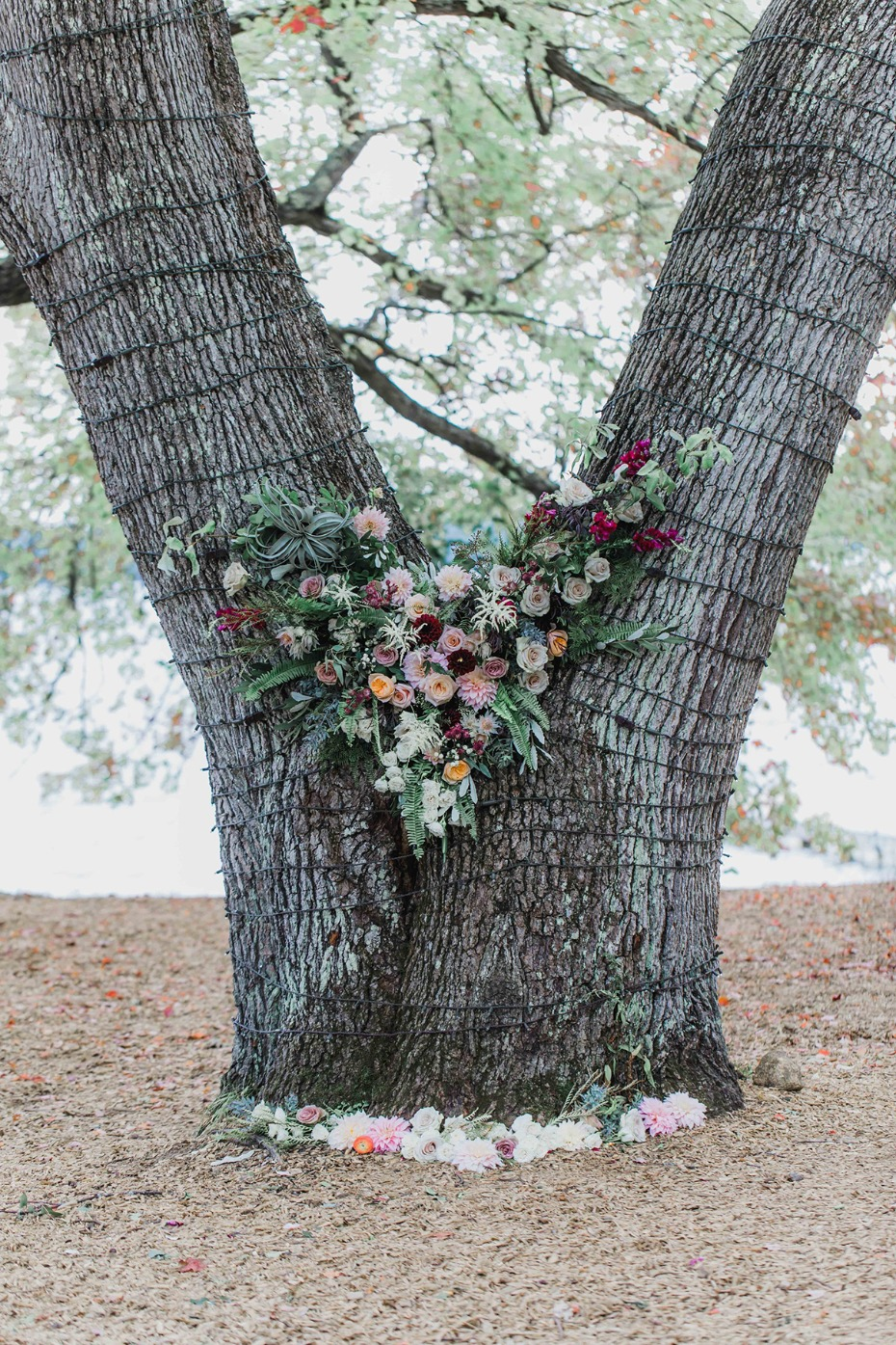 floral accented wedding tree backdrop