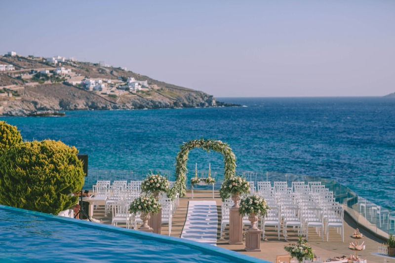 Georgeous ceremony set-up in Mykonos with an incredible view on the Aegean sea! #Mykonos #mykonosweddings #greeceweddings #lilyofthevalley_events