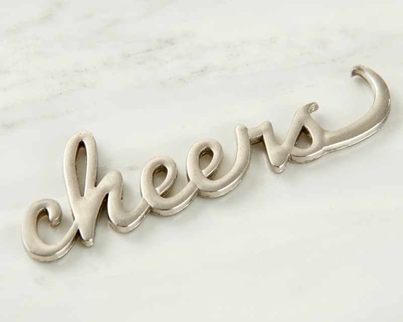 Toast to celebration with this Cheers Silver Bottle Opener! This silver bottle opener favor is the perfect bridal party gift to thank