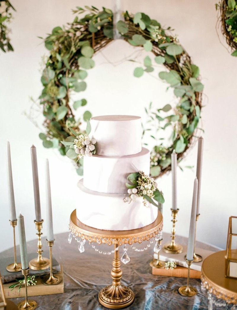 Opulent Treasures signature chandelier cake stand in antique gold, created for treasuring special memories like your wedding day!