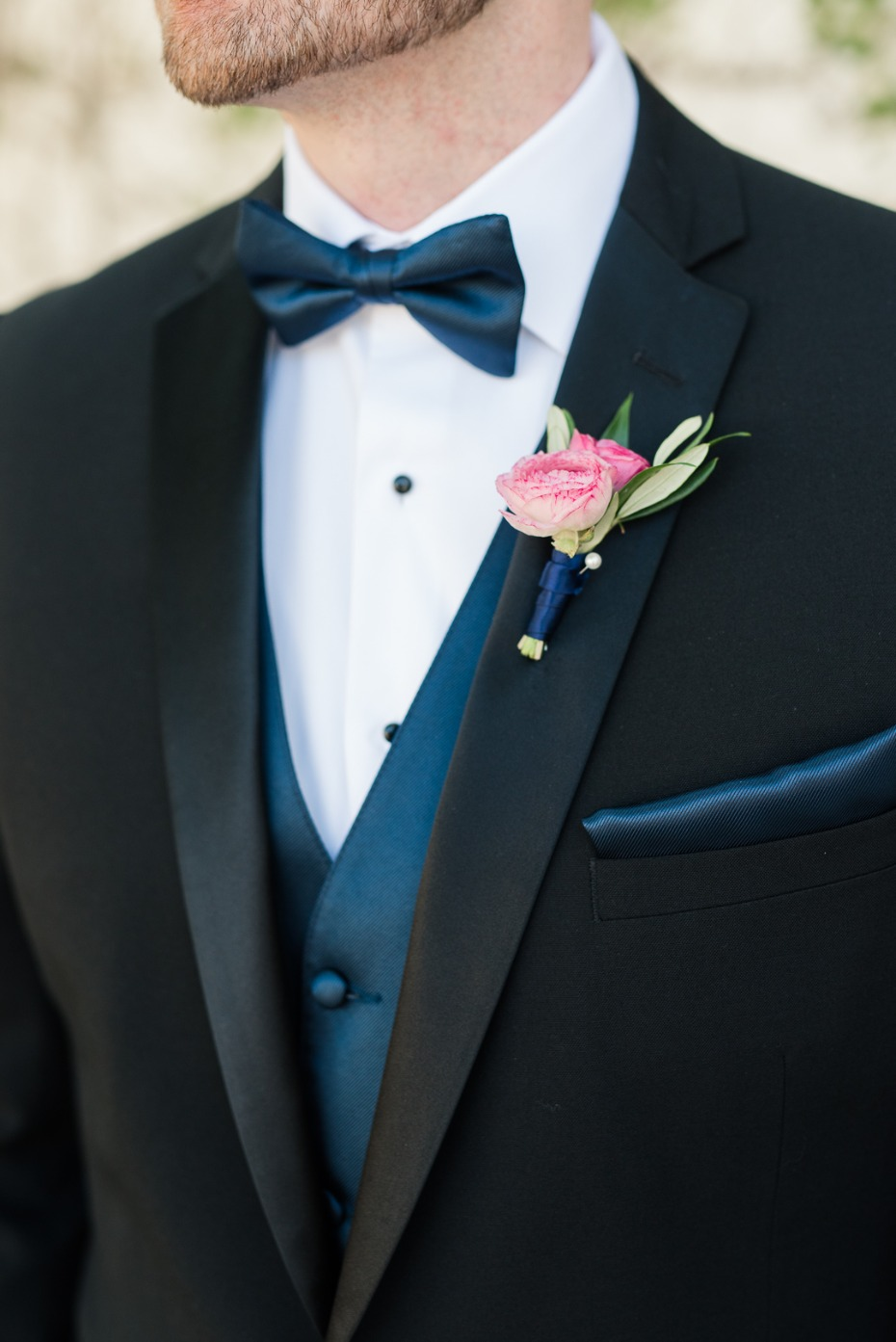 groom in black and navy