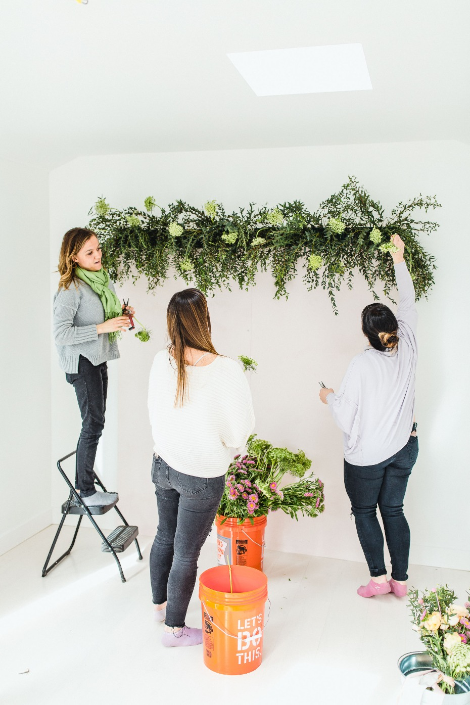 how to make a flower backdrop wall