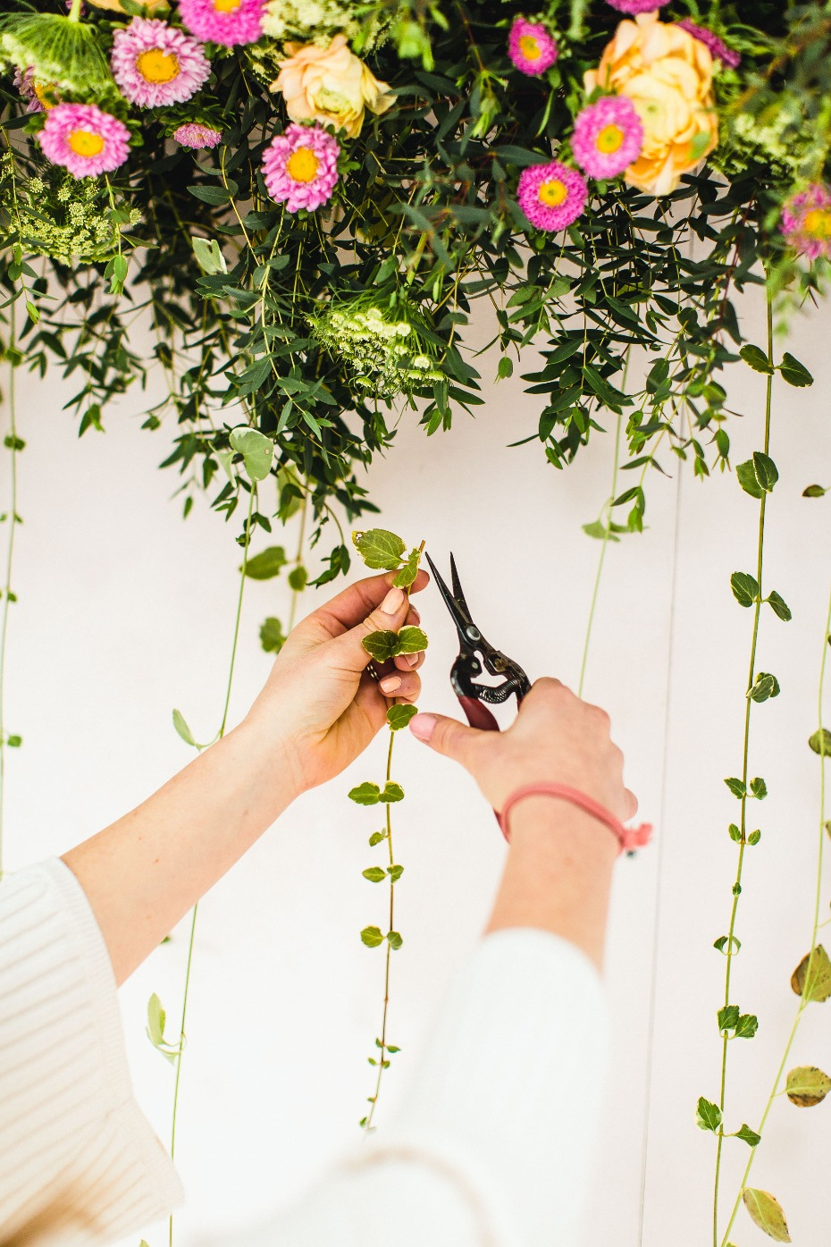 hanging ivy to add depth to our photo booth backdrop