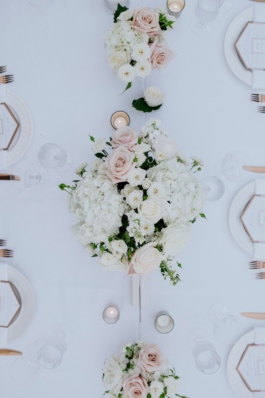 white and blush wedding centerpiece