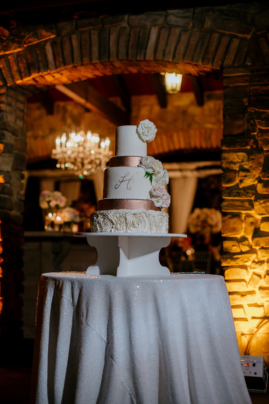 white and copper wedding cake