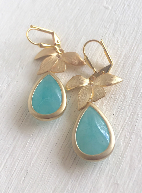 Awesome! Lovely! Elegant! Aqua teardrops with the gold orchid is just stunning and lovely!