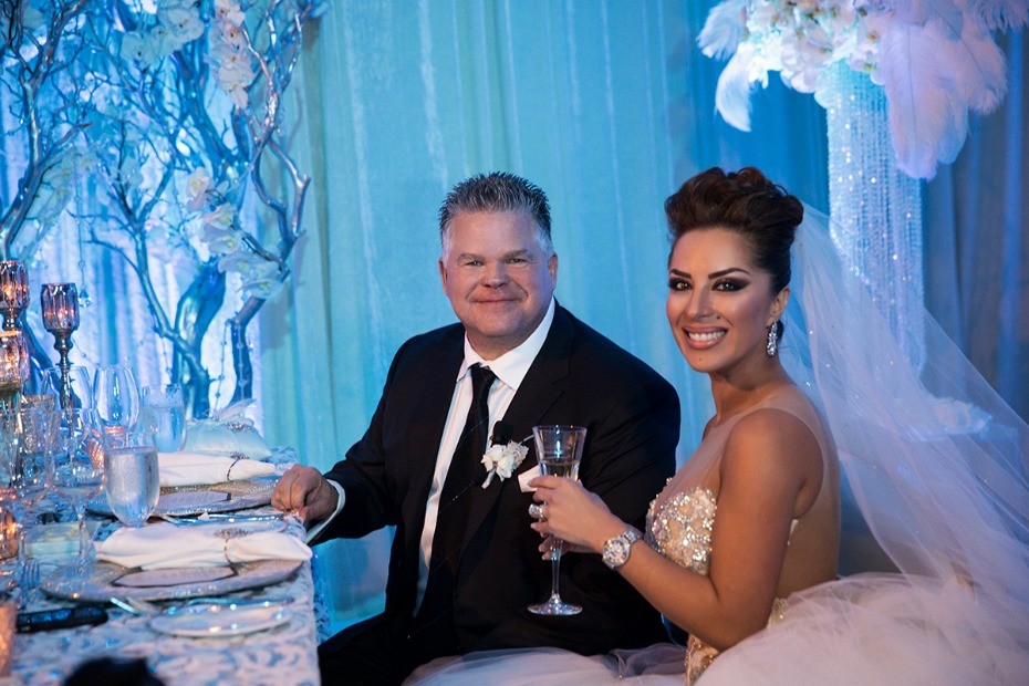 happy newlyweds at their sweetheart table
