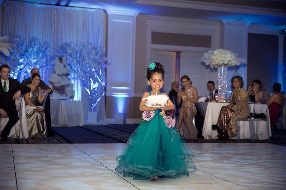 sweet little flower girl in deep teal and floral dress