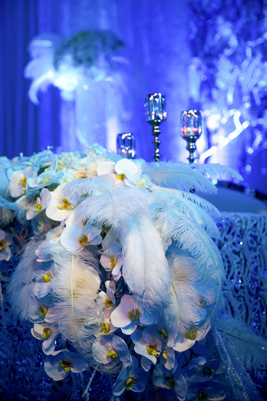 glamorous feathers and orchid winter wedding reception decor