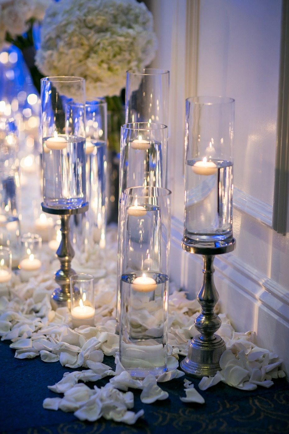 setting the mood with floating candles and oodles of flower petals