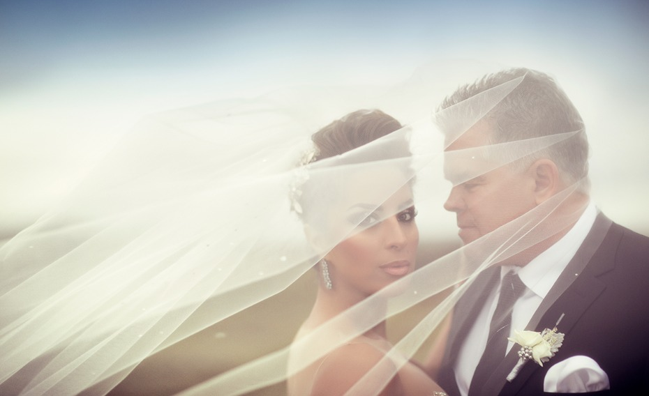romantic and dramatic wedding portrait of the bride and groom