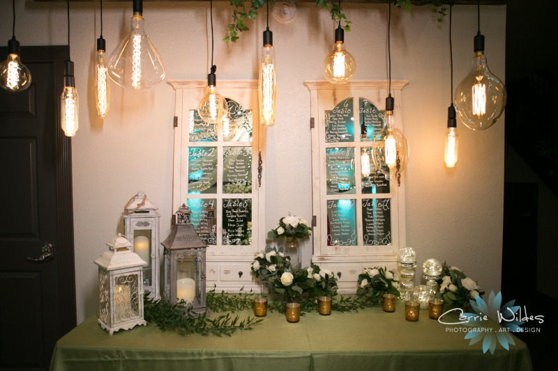 Unique setup for a seating chart ! We love vintage light bulbs above mirrored doors !