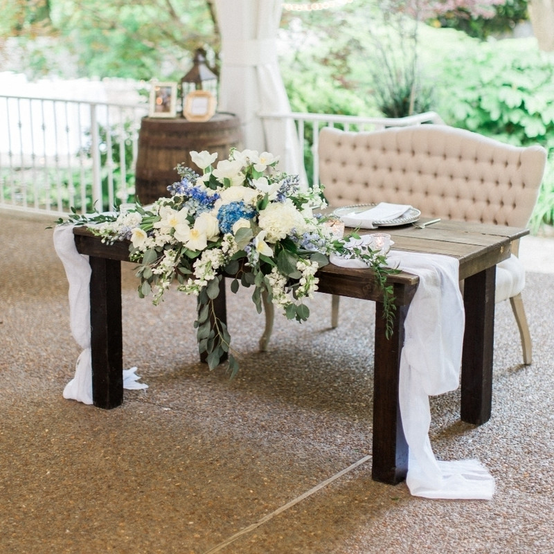 A sweetheart table with a gorgeous centerpiece by @enchantedfloristtn