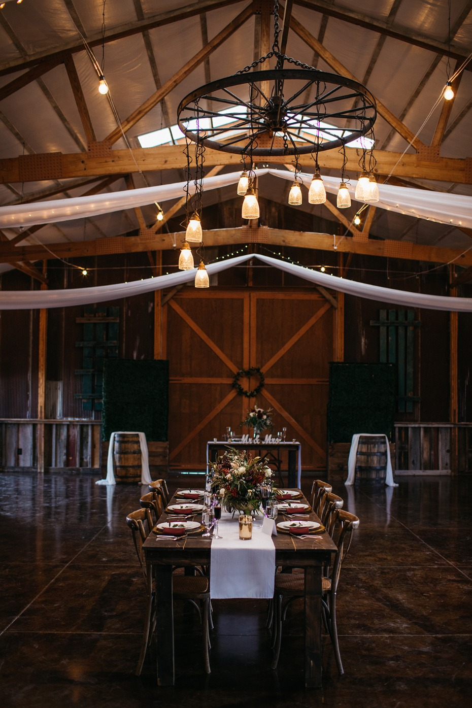 rustic chic fall wedding reception in a barn