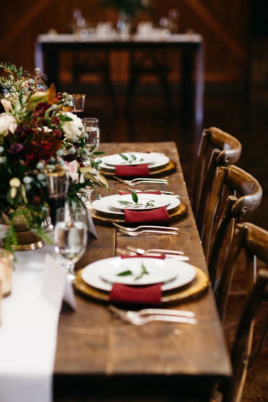 rustic chic late fall wedding table decor with gold and burgundy accents