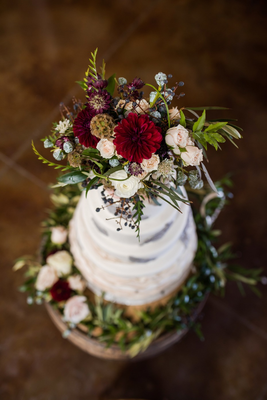 rustic and wild inspired flower topped wedding cake