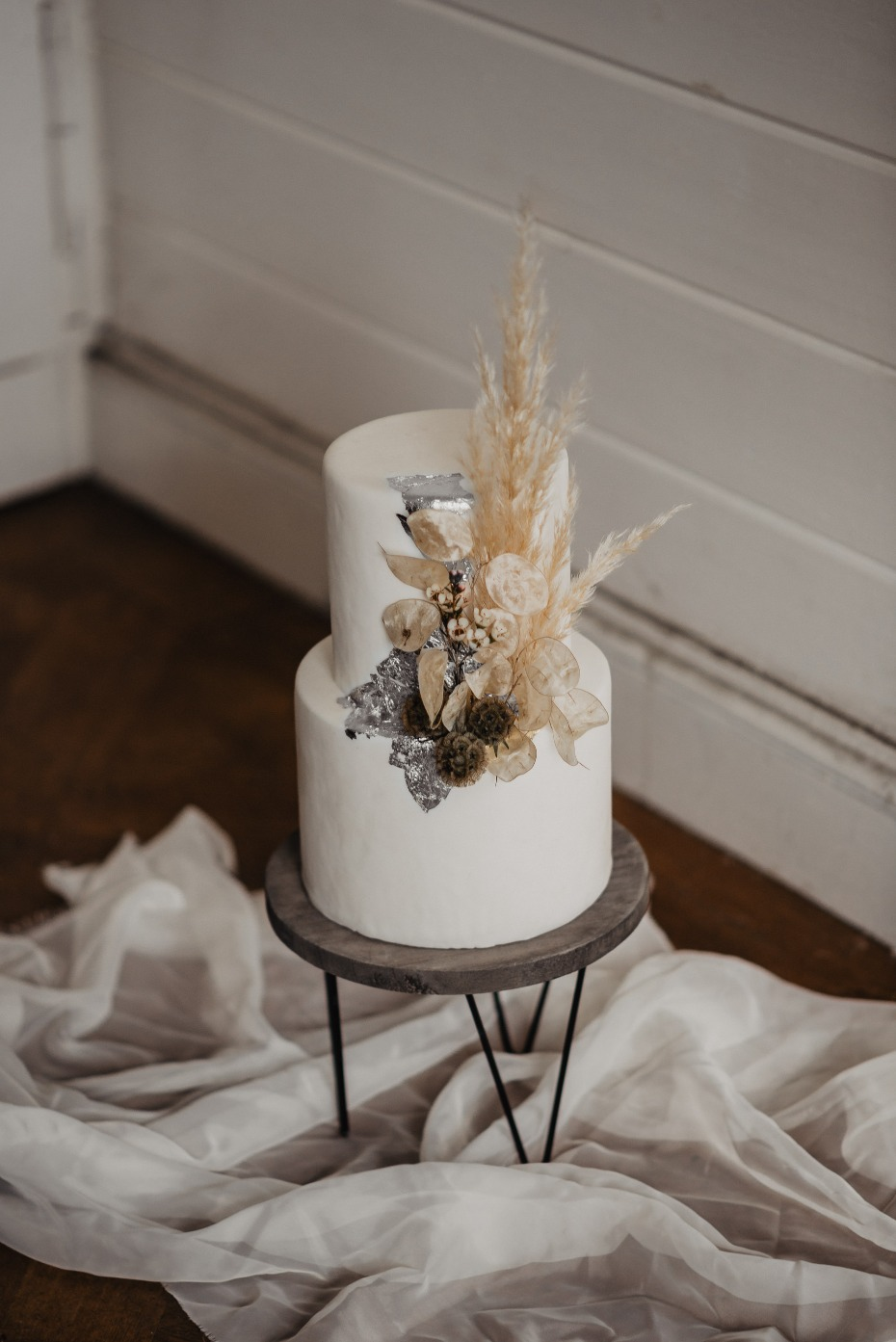 white and silver cake unique floral accent