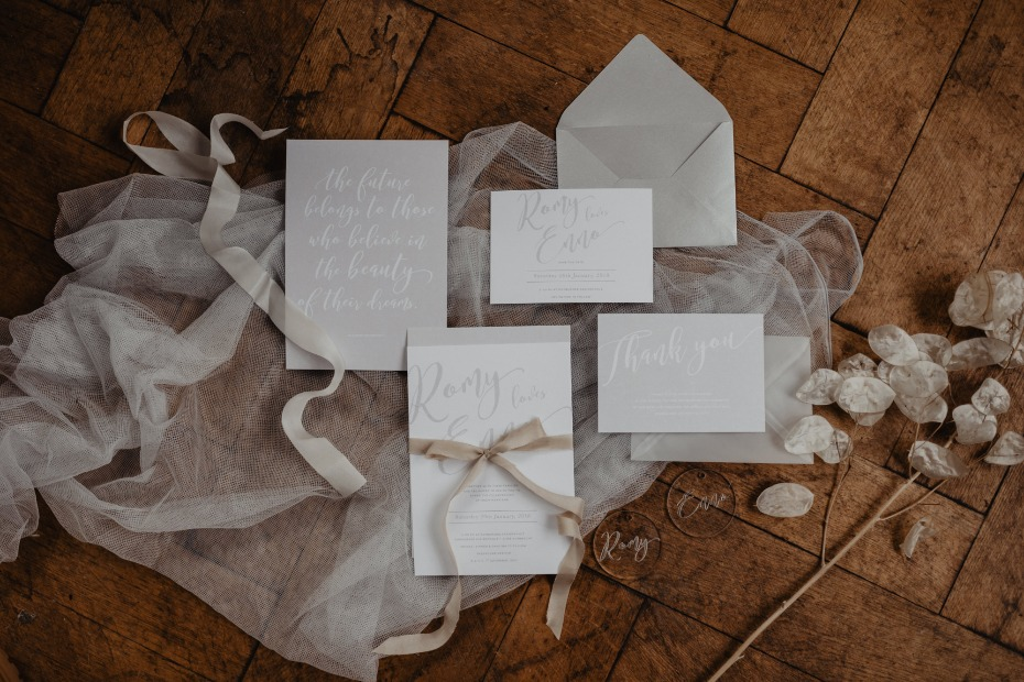 Silver and white invitation suite