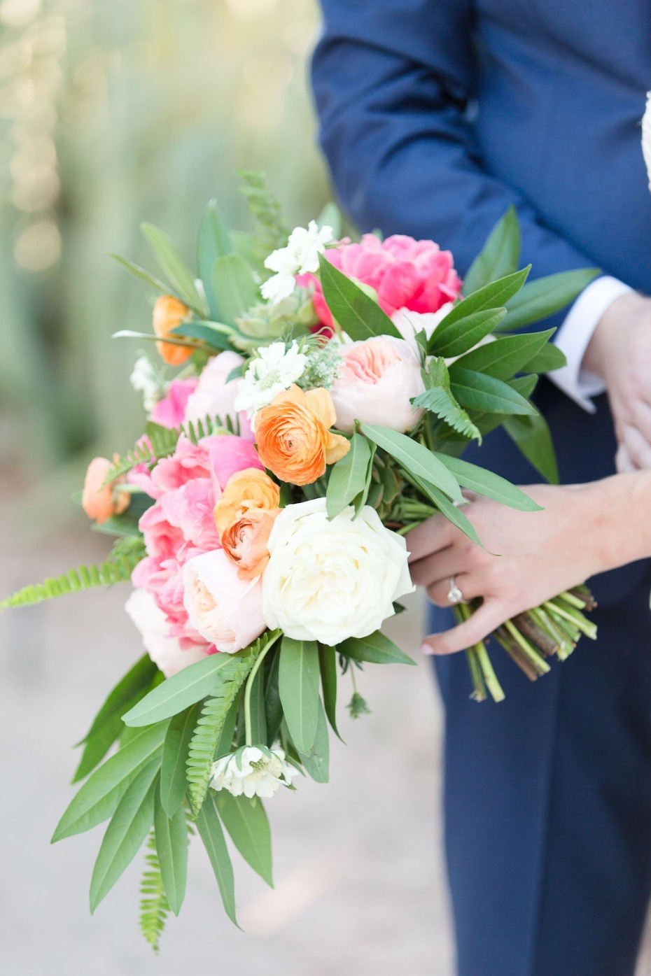 orange and pink wedding bouquet perfect for your summer wedding