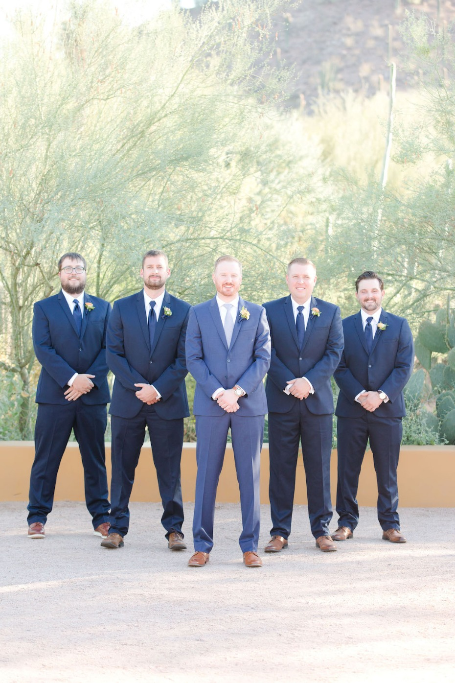 groom and his groomsmen in navy and royal blue
