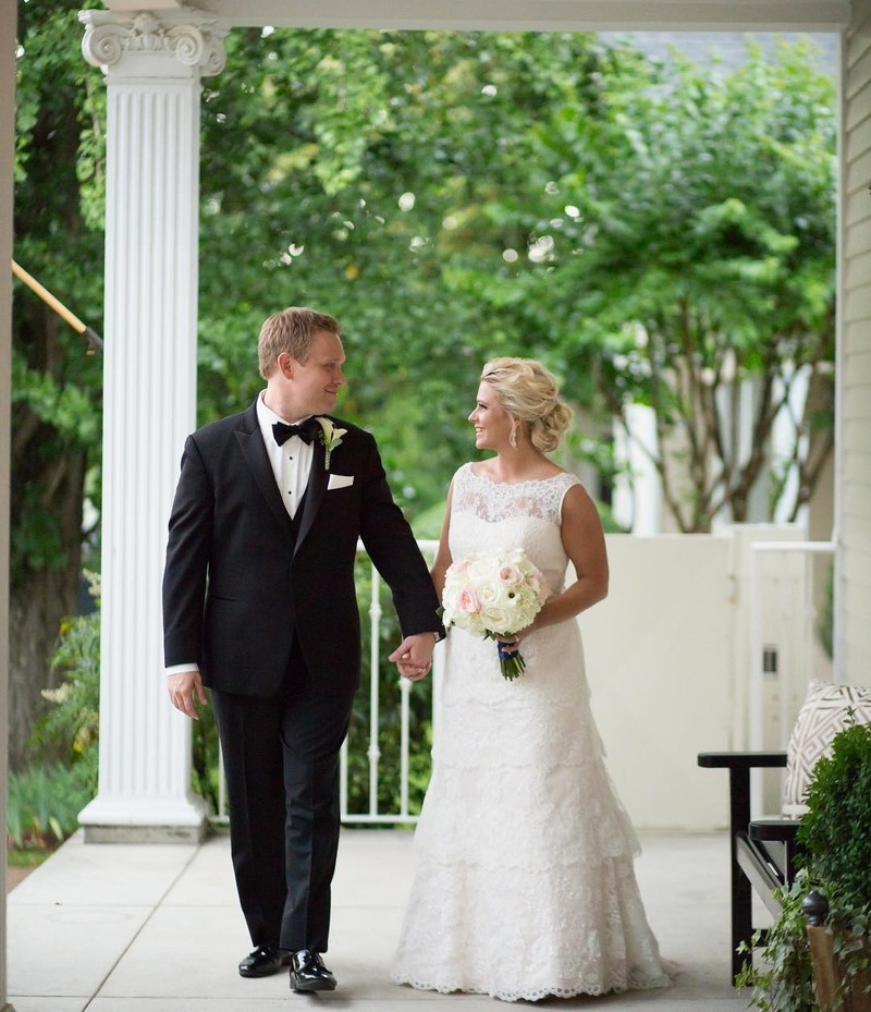 Love this moment on our front porch. So classic and so Southern! Cheers Heather + Rick!