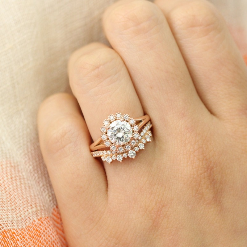 This Vintage Luna Halo Round Forever One Moissanite plus this crown diamond wedding band makes for a unique, swoon-worthy bridal set
