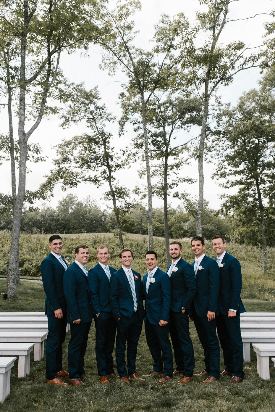 Matching groomsmen in navy suits
